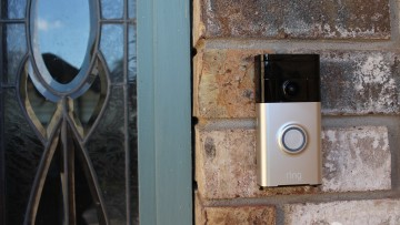 Ring Video Doorbell installed on a wall next to a door