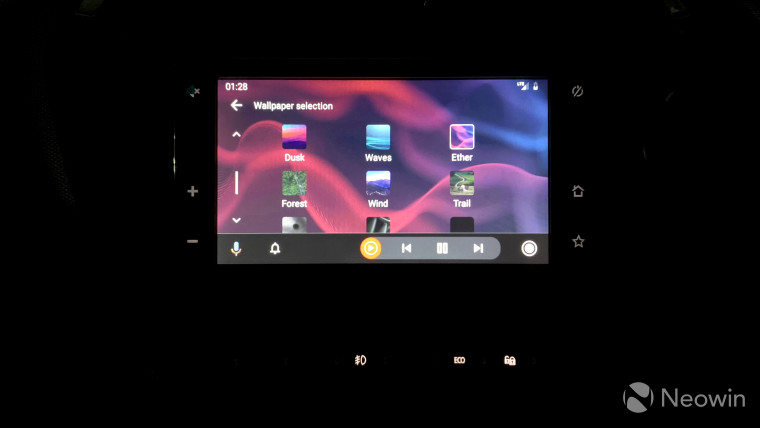 Car head unit with Android Auto screen housing wallpaper settings
