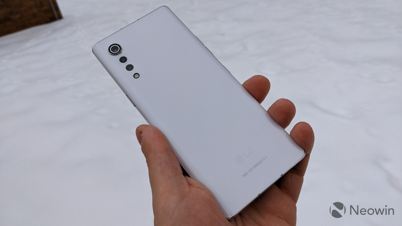 LG Velvet held in hand with snowy background