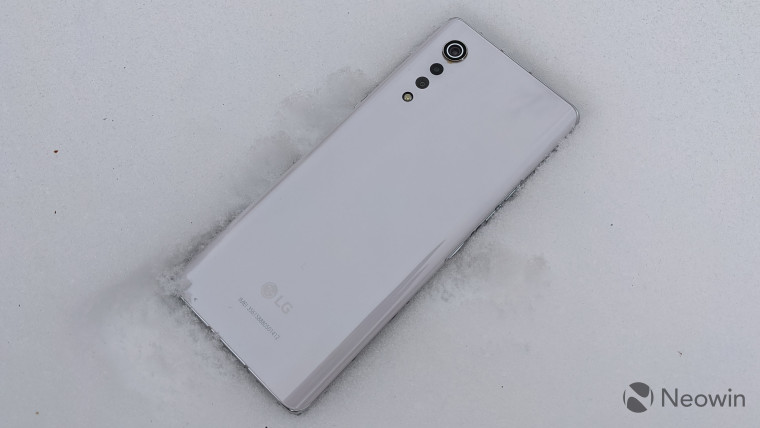 LG Velvet smartphone on top of snow
