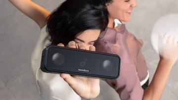 woman holding an anker soundcore speaker