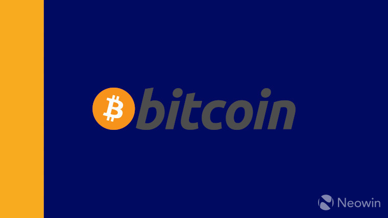 The bitcoin logo on a blue and gold background