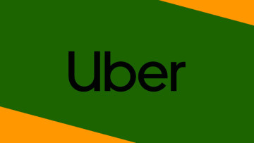 The Uber logo on a green and orange background