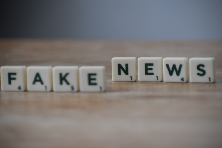Pieces of Scrabble spelling out the words Fake News