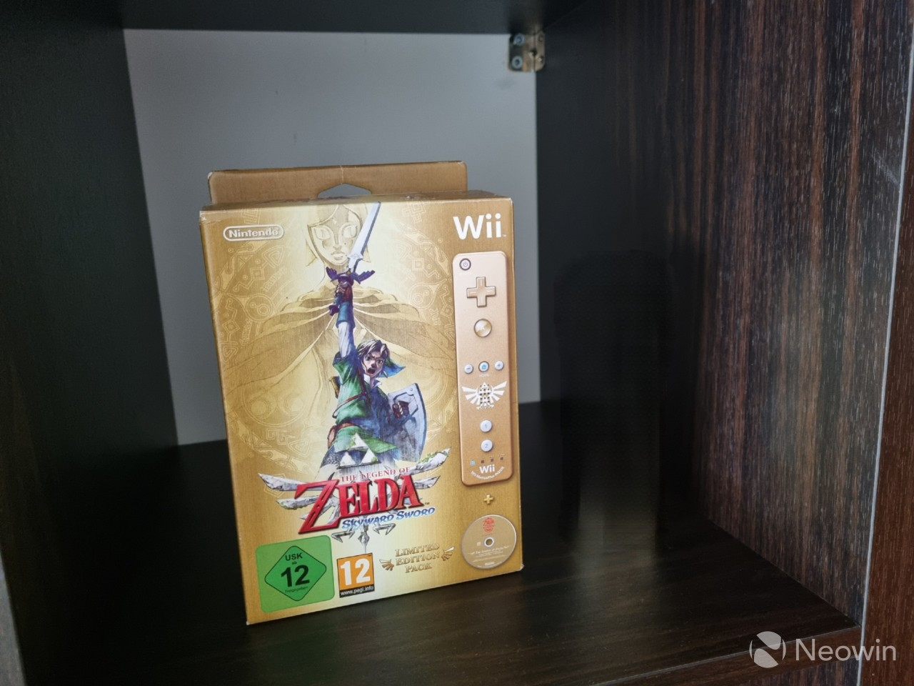 A video game box with the Wii Remote next to it removed using Object Eraser