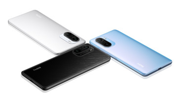 The Redmi K40 series with their back panels being shown in Glossy Black, Icy White, and Dreamland co