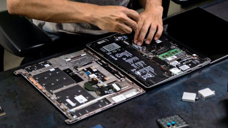 A Framework Laptop with its bottom cover removed showing its internal components