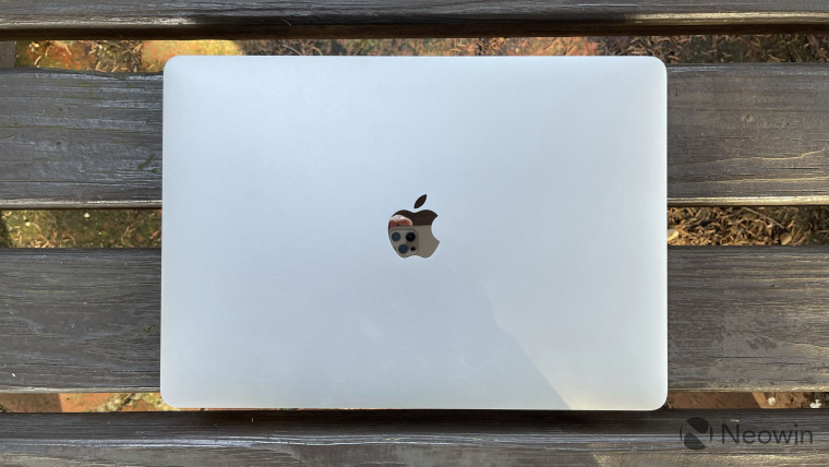 Top-down view of MacBook Pro on wooden bench