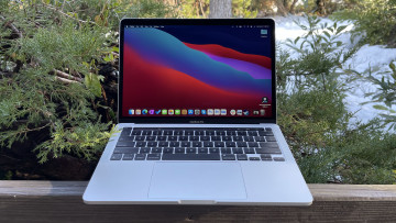 Front view of the MacBook Pro on with bushes in background