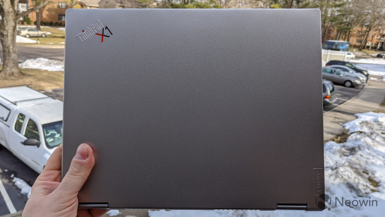 ThinkPad X1 Titanium Yoga being held with one hand