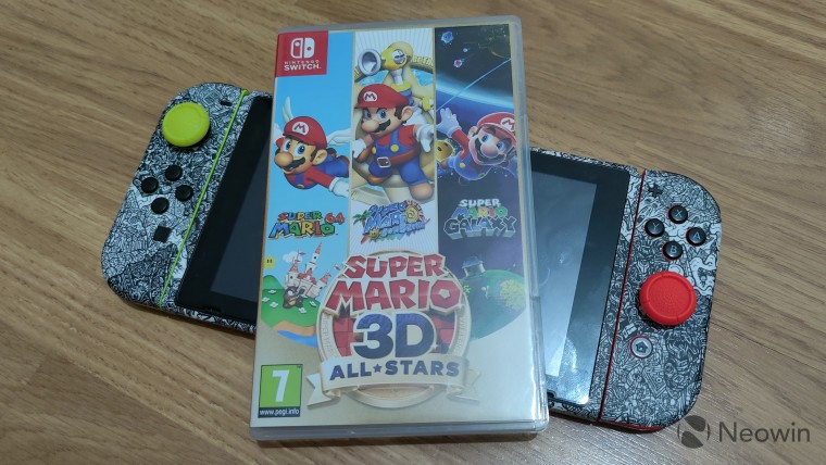 Super Mario 3D All-Stars box on top of a Nintendo Switch system