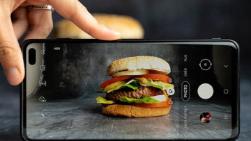 Hamburger being photographed by a phone