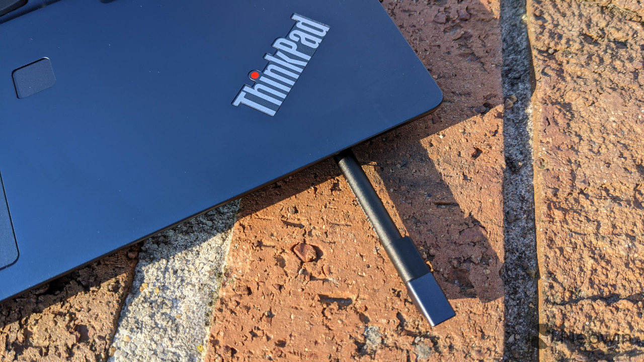 ThinkPad C13 Yoga close-up showing pen partially ejected from garage