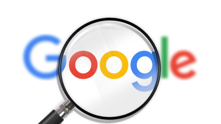 Magnifying glass over google logo