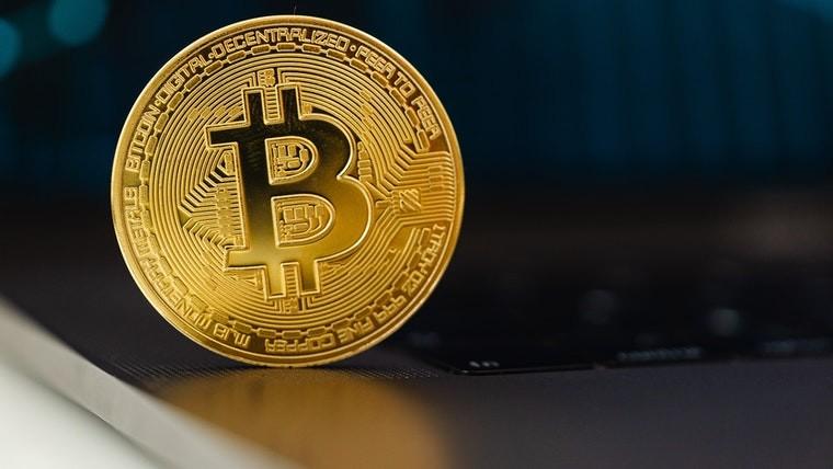 A physical bitcoin on a table