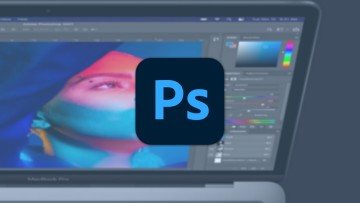Photoshop logo on top of a picture of a MacBook Pro
