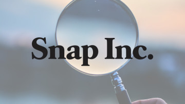 The Snap Inc logo over a magnifying glass to symbolise research