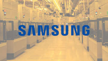 The Samsung logo with a Samsung factory in the background