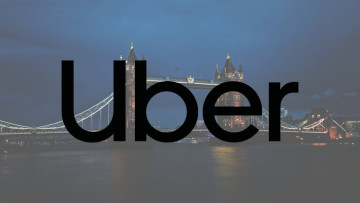 The Uber logo with Tower Bridge in the background