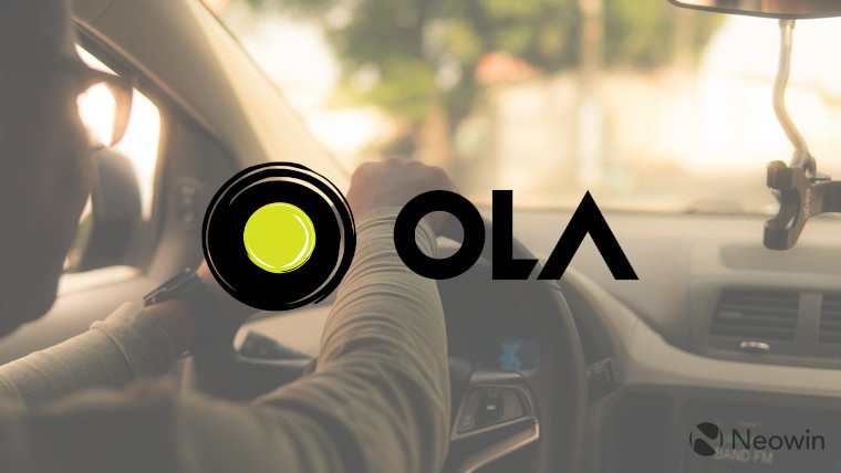 The Ola logo with an interior taxi background