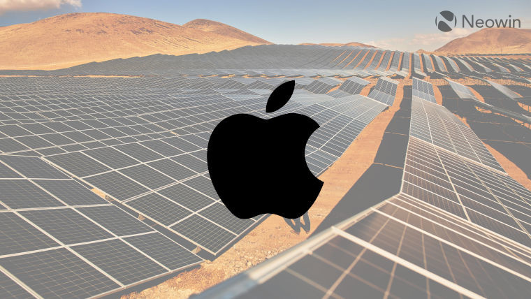 The Apple logo in front of solar panels