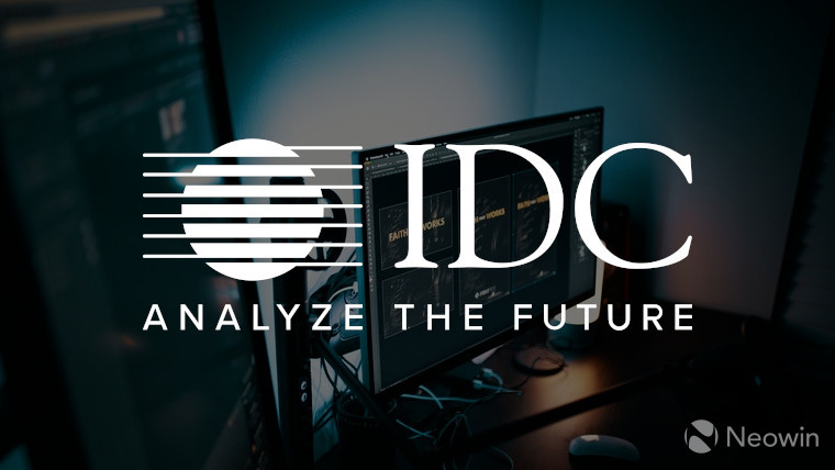 The IDC logo with monitors in the background