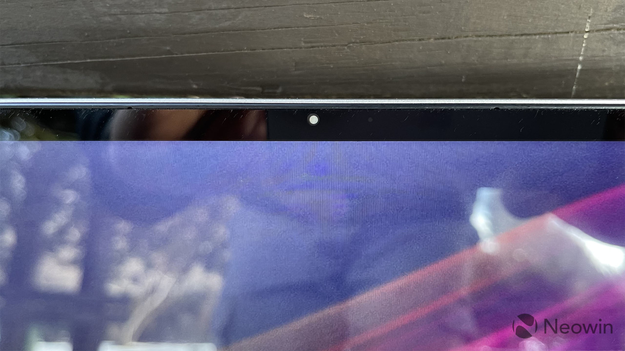 HP Envy 14 top bezel showing webcam with privacy guard