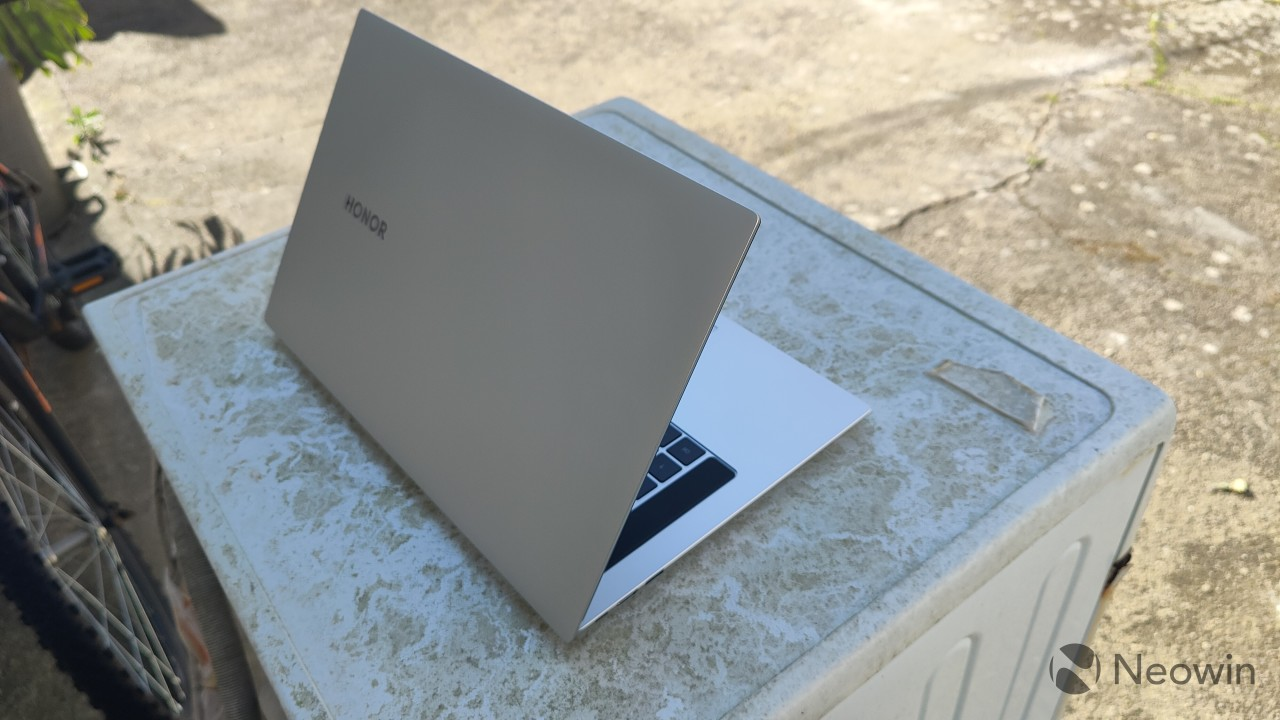 Right-angle rear view of the MagicBook Pro with the lid partly open