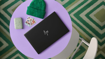 HP Envy x360 15 in Nightfall Black on purple table