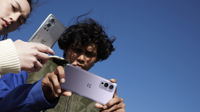Users holding OnePlus 9 and OnePlus 9 Pro