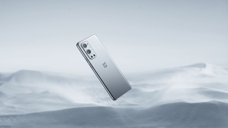 OnePlus 9 Pro in Morning Mist weirdly floating above gray sand