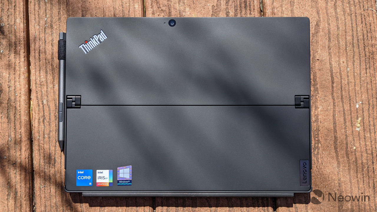 Top-down view of ThinkPad X12 Detachable with wood background