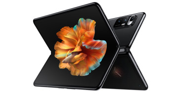 Front design of Xiaomi&039s Mi Mix Fold smartphone sitting horizontally against the back of another
