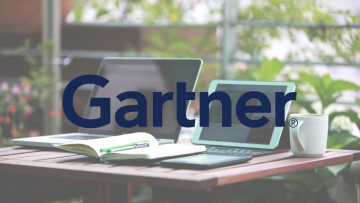 The Gartner logo in front of a laptop and a tablet