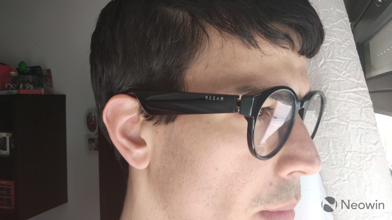Side view of a man wearing Razer Anzu Smart Glasses with blue light filtering lenses