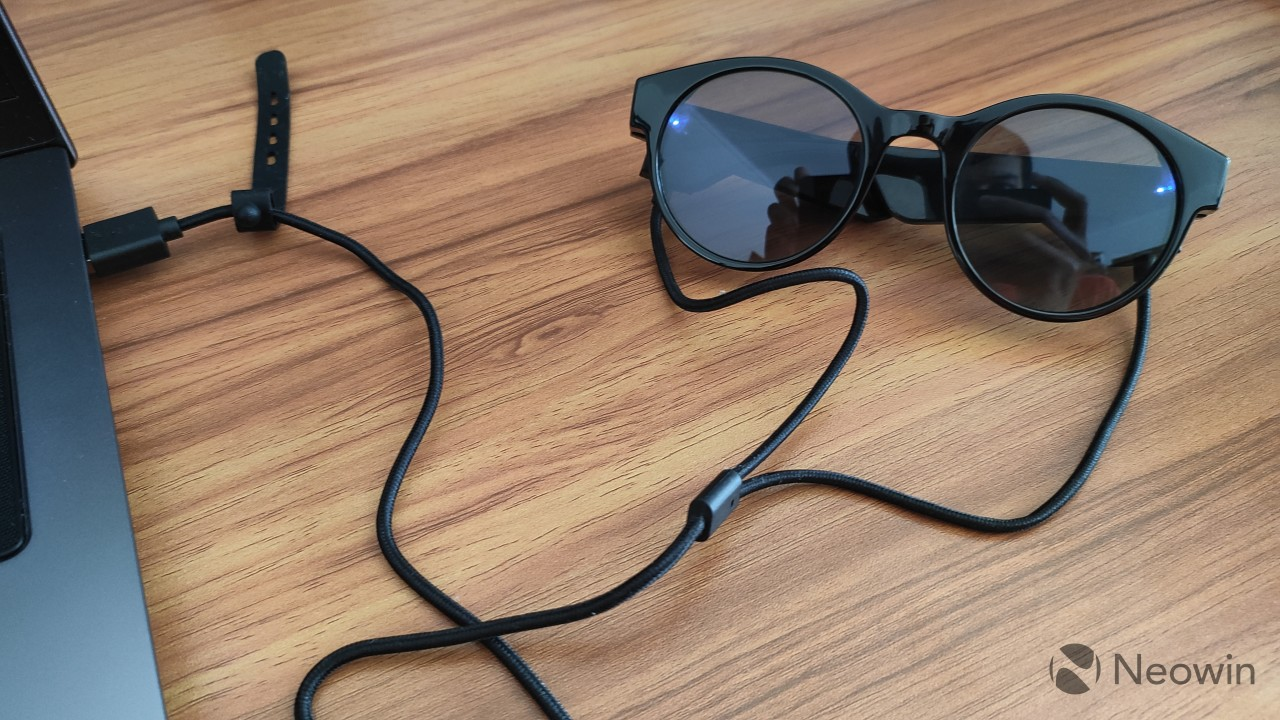 Razer Anzu Smart Glasses connected to the including pin charger