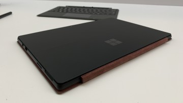Black Surface Pro 6 with a Burgundy Type Cover attached