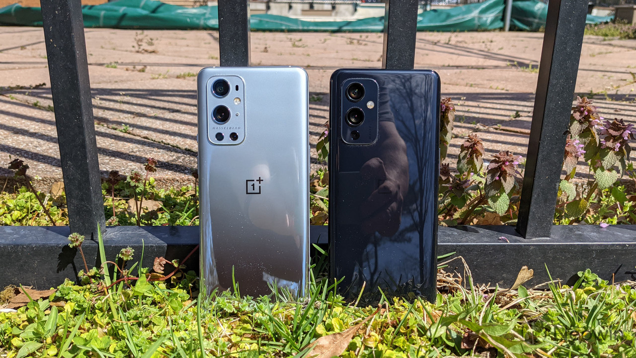 OnePlus 9 Pro and OnePlus 9 standing against fence