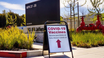 A COVID-19 vaccine sign outside of Menlo Park