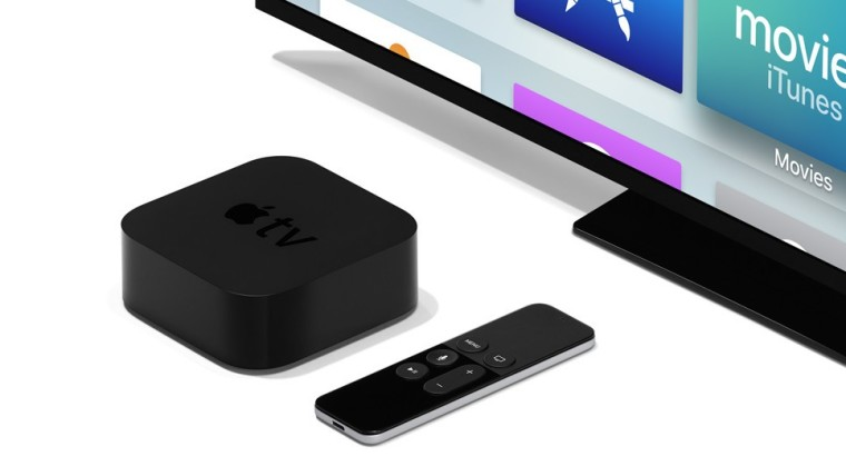 Apple TV set-top box and its remote in front of a TV