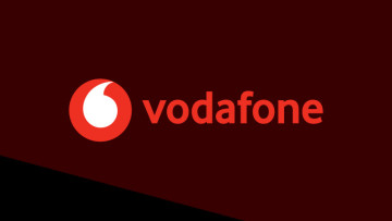 The Vodafone logo on a dark red and black background