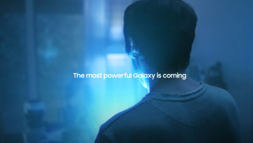 Screen grab from Samsung&039s teaser showing a man turning his back to face a box glowing in blue li