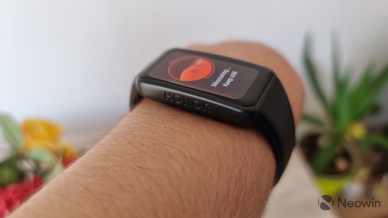 Honor Band 6 on a wrist seen from the left where the Honor logo is