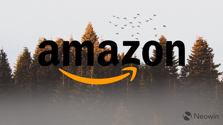 The Amazon logo in front of trees
