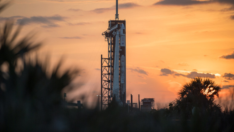 The Falcon 9 with a Crew-2 Dragon atop it
