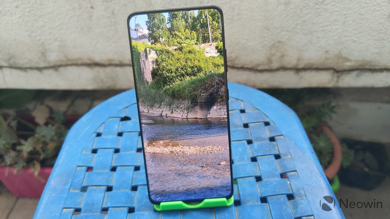 Samsung Galaxy S21 Ultra standing up on a kickstand with the display showing a photo in fullscreen