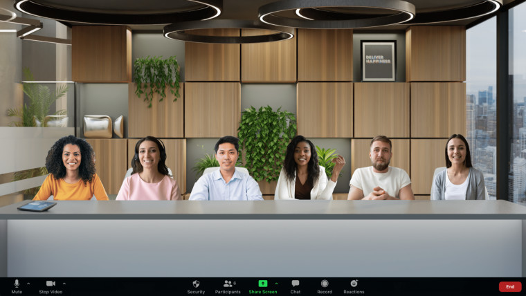 A Zoom meeting with participants placed in a virtual office room