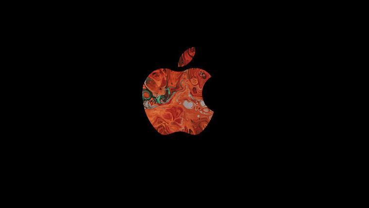 A multicoloured Apple logo on a black background