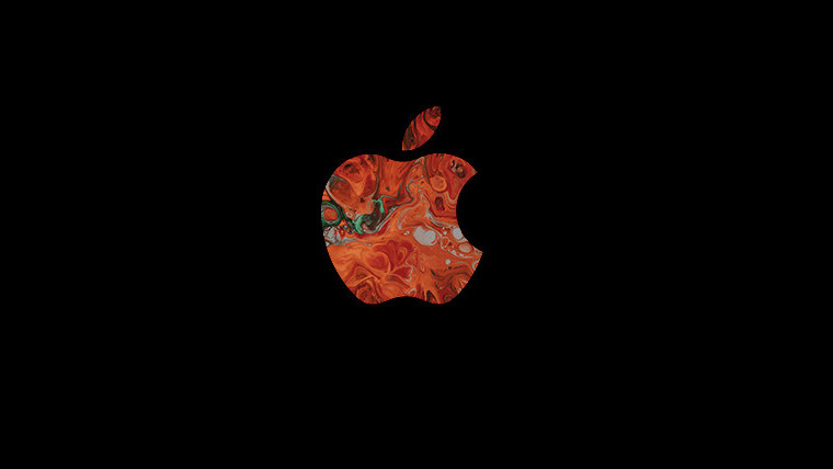 A multicoloured Apple logo on a black background