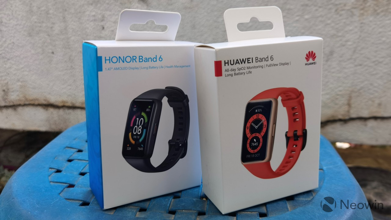 Huawei Band 6 and Honor band 6 packages standing next to each other